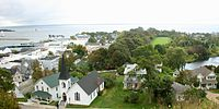 Mackinac Island, an island and resort area at the eastern end of the Straits of Mackinac. More than 80 percent of the island is preserved as Mackinac Island State Park.