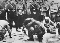 March or April 1938: Jews are forced to scrub the pavement in Vienna, Austria.