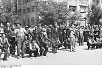 Greek Jews from Saloniki are forced to exercise or dance, July 1942.