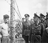 Heinrich Himmler inspects a POW camp in Russia, c. 1941.