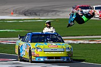 Edwards does a backflip, after winning at Texas Motor Speedway