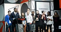 Coogler accepts the U.S. Grand Jury Prize: Dramatic with the crew of Fruitvale Station at the 2013 Sundance Film Festival.