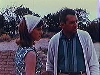 Frame from a public domain DVD release, depicting Harold P. Warren and Diane Mahree.