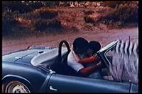 This scene shows a failure to edit out the clapperboard, which was momentarily visible for a few frames on the right side of the image.