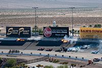 The crash scene just shortly after it began. Dan Wheldon's car, seen at the bottom of the picture, has just left the racing surface.