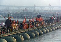 A procession of pilgrims cross the Ganges during the 2001 Kumbh Mela in Allahabad