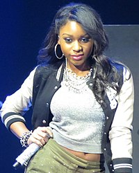 Normani performing at an iHeartRadio event in 2013 as a member of Fifth Harmony.