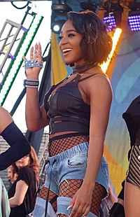 Normani performing in 2017 with Fifth Harmony.