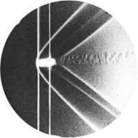 Ernst Mach's historic 1887 photograph (shadowgraph) of a bow shockwave around a supersonic bullet