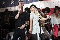 Levine and Aguilera singing together in the music video.