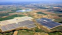 Photovoltaic plants (foreground) and solar thermal plants (background) in the province of Seville