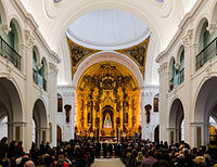 The interior of the Hermitage of El Rocío during a Catholic ceremony.