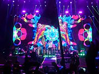 """Coldplay performing """"Adventure of a Lifetime"""", during their headline setlist at Glastonbury 2016. The performance was their fifth at the festival, and a record-setting fourth as headliners."""