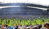 Manchester City supporters invade the pitch following their 2011–12 Premier League title win.