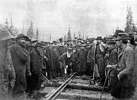 Lord Strathcona drives the Last Spike of the Canadian Pacific Railway, at Craigellachie, November 7, 1885. Completion of the transcontinental railroad was a condition of entry into Confederation.