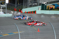 Harvick (#21) during his 2006 Busch championship season, racing Dale Earnhardt, Jr. (#8) off pit road