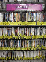 A used game rack for GameCube games at a GameStop in San Bruno, California