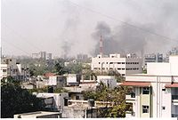 The skyline of Moradabad filled with smoke as buildings and shops are set on fire.