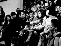 Dick Clark talks to Myrna Horowitz, one of the original dancers when the program began in 1952, on the show's 18th anniversary in 1970.