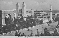 Mogadishu, capital of Italian Somaliland, with the Catholic Cathedral at the center and the Arch monument in honor of King Umberto I of Italy.