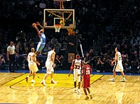 Anthony receiving an alley-oop during the 2004 Rookie Challenge game for the Rookies team.