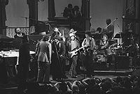The Last Waltz, Young (center on left microphone) performing with Bob Dylan and The Band, among others in 1976