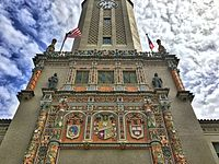 Tower at the University of Puerto Rico, showing (right) the emblem of Harvardthe oldest in the United Statesand (left) that of National University of San Marcos, Limathe oldest in the Americas