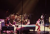 Preston (seated behind grand piano in foreground) performing with the Rolling Stones in 1975