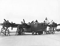 Maintenance mechanics at Laredo Army Air Field, Texas, give a Consolidated B-24 Liberator a complete overhaul before flight, 8 February 1944.