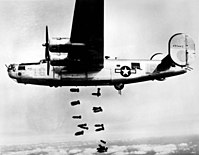 A B-24M of the 451st BG releases its bombs on the railyards at Mühldorf, Germany, on 19 March 1945