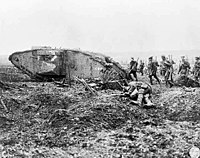 Canadian troops advancing with a British Mark II tank at the Battle of Vimy Ridge, 1917