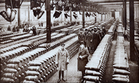 King George V (front left) and a group of officials inspect a British munitions factory in 1917.