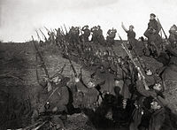 Bulgarian soldiers in a trench, preparing to fire against an incoming aeroplane