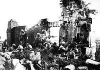 French soldiers under General Gouraud, with machine guns amongst the ruins of a cathedral near the Marne, 1918