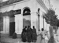 Sarajevo citizens reading a poster with the proclamation of the Austrian annexation in 1908