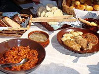 Selection of hearty traditional comfort food from Poland including bigos, cabbage rolls, żurek, pierogi, oscypek and specialty breads