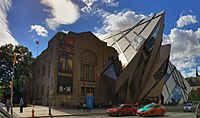 """The Royal Ontario Museum was originally designed in a Romanesque Revival style, although other styles have since been added to the building. Architecture in Toronto has been called a """"mix of periods and styles""""."""