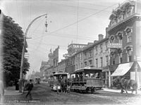 Horse-drawn streetcars in 1890. The city's streetcar system transitioned to electric-powered streetcars in 1892.
