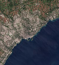 Satellite image of Toronto and surrounding area. Urban areas of the city are interrupted by the Toronto ravine system.