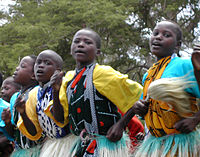 Kenyan boys and girls performing a traditional dance
