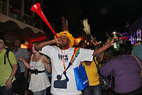 A man sounding a vuvuzela