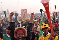Supporters watching the 2010 FIFA World Cup in South Africa, with vuvuzelas.
