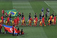 The Brazilian and North Korean teams before their group stage match