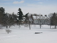 Forbes College in winter from the golf course