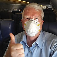 Brooks wearing a facemask on an airplane in May 2020
