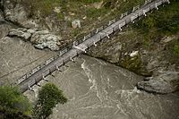 A white border painted on a suspended bridge delineates Azad Kashmir from Jammu and Kashmir