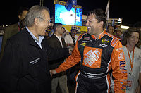 United States Secretary of Defense and grand marshal Donald Rumsfeld (left) and Stewart share a laugh before the 2005 Pepsi 400