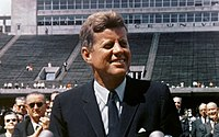 Kennedy speaking at Rice University in Houston on September 12, 1962. Vice President Lyndon B. Johnson can be seen behind him.