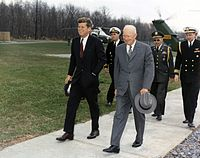 Outgoing President Dwight D. Eisenhower meets with President-elect John F. Kennedy at Camp David
