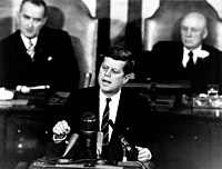 Kennedy proposing a program to Congress that will land men on the Moon, May 1961. Johnson and Sam Rayburn are seated behind him.